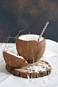 Coconut, opened, with a straw
