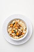 Conchiglie with pumpkin, porcini mushrooms and crumbled Parmesan crisps