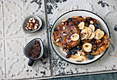 Blueberry chocolate pancakes with banana and hazelnuts