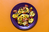 Fried curried cauliflower with tomatoes