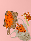 Carrots being cut into ribbons with a peeler