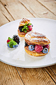 A choux pastry doughnut with chocolate cream and berries