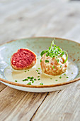 Beetroot dumplings with a cheese sauce