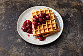 Oat waffles with cherry compote