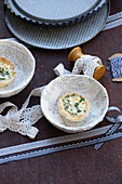 Small cheese quark quiches with herbs