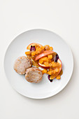 Sage pork medallions with a pumpkin and apple compote