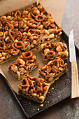 Pecan macadamia slices with pretzels and caramel