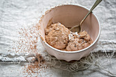 Pink bowl of Chocolate Ice Cream on a linen cloth