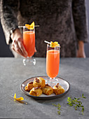 Carrot rolls with blood orange and champagne cocktails