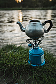 A coffee pot on a camping stove