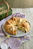 Easter Bread wreath with herb and ham filling and baked eggs