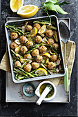 Oven-baked dumplings with green asparagus, spring onions and lemon