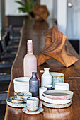 Wooden objects and handicraft ceramics on a long bar counter