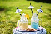 Frappes in two glasses, decorated with little umbrellas