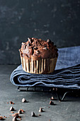 Yummy muffin made with chocolate and banana on blue towel