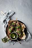Charred lamb-rump skewers with salsa verde