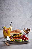 A chicken burger with pickled mango