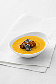 Cream of pumpkin sauce with poppyseed and pepper gorgonzola