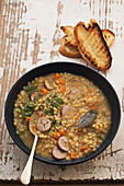 Split pea and lentil soup with sausage dumplings