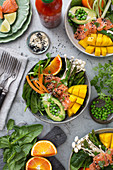 Healthy vegetable and fruit bowl with salmon