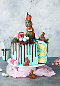 An Easter cake decorated with a chocolate bunny, sliced