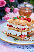 A mille feuille with cream and strawberries