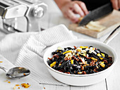 Black pasta with sun-dried vegetables
