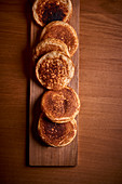 Blinis on a wooden board