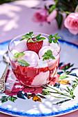 Rose ice cream with meringue, raspberries and rose preserve
