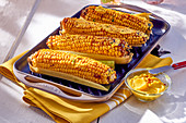 Grilled corn cobs with curry butter