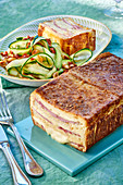 Spicy croque monsieur cake and courgette salad