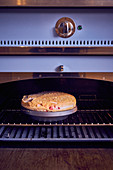 Gratinated floating island with berries in an oven
