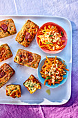 Spicy mini chorizo and spinach cakes and carrot salad with peanuts