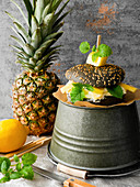 A black burger with lemon quark, pineapple and lemon balm