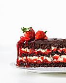 A chocolate cake with strawberries and white chocolate mousse