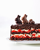 Chocolate cake with strawberries and white chocolate mousse for Easter