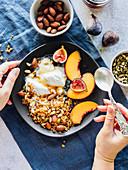 Yogurt bowl with granola, nuts and fruits