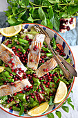 Salad with pomegranate and fish