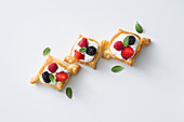 Square berry and cream tartlets