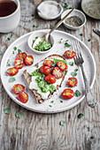 Mozzarella toast with basil pesto and roasted cherry tomatoes