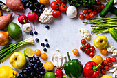 Various summer vegetables and fruits - Enoki mushrooms, asparagus, cherry tomatoes and berries