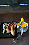 Turkey sausages with a pecorino flan and pumpkin seed sauce