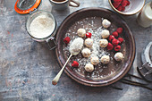 Coconut truffles with raspberries