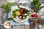 Millet salad with pesto, rocket, spinach, tomatoes and feta