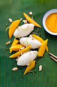Sticky rice with mango wedges and mango cream