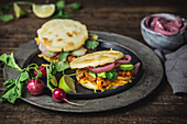 Arepas with chicken and sauce