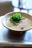 Wild herb and potato soup with salsiccia