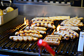 Sausages being grilled