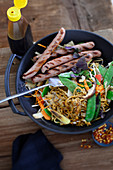 Fried mie noodles with turkey sausage and vegetables
