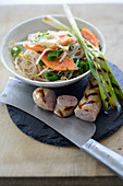 Veal sausages with a papaya and glass noodle salad